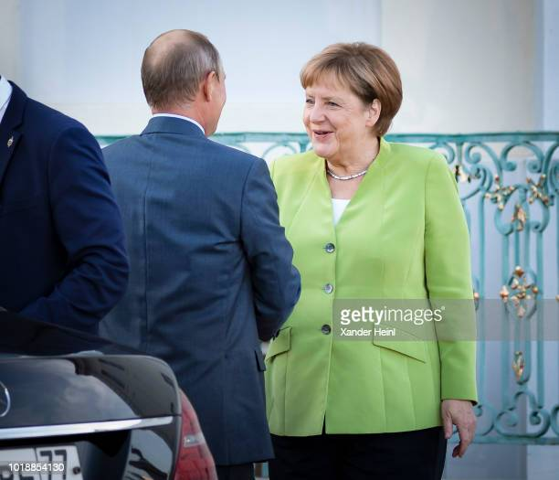 German Chancellor and leader of the German Christian Democrats Angela Merkel welcomes the Russian President Vladimir Putin at Schloss Meseberg palace...
