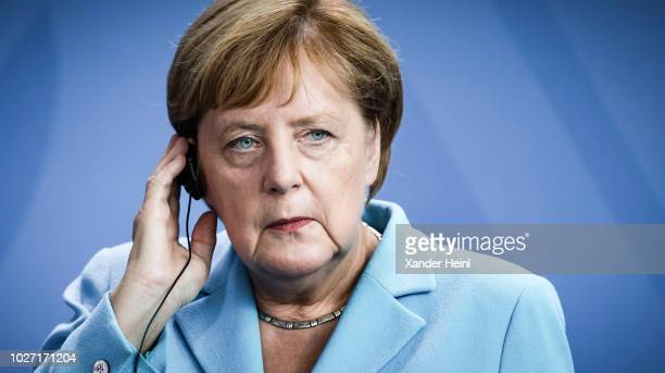German Chancellor and leader of the German Christian Democrats Angela Merkel listens to a translator on September 05 2018 in Berlin Germany
