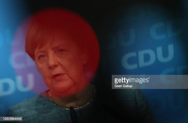 German Chancellor and leader of the German Christian Democrats Angela Merkel is seen through the red light of a television camera as she and CDU lead...