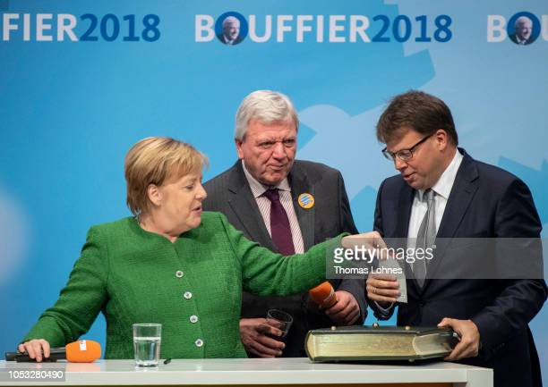 German Chancellor and leader of the German Christian Democrats Angela Merkel lead local CDU candidate Volker Bouffier and the mayor of Fulda Dag...
