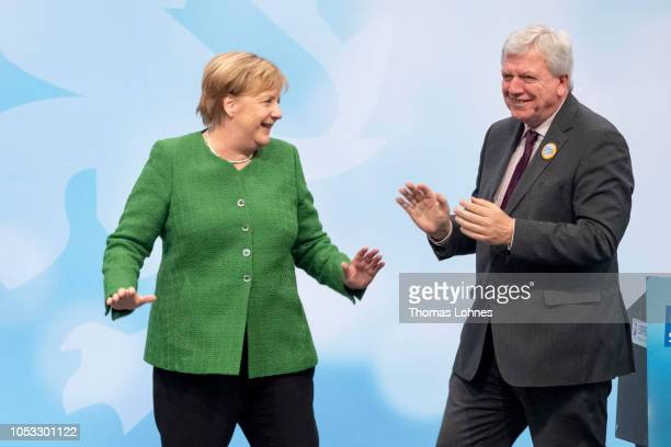 German Chancellor and leader of the German Christian Democrats Angela Merkel and lead local CDU candidate Volker Bouffier attend a CDU Hesse state...