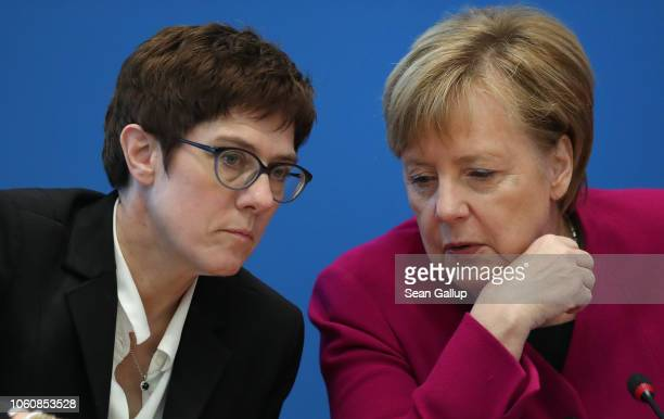 German Chancellor and leader of the German Christian Democrats Angela Merkel chats with CDU General Secretary Annegret KrampKarrenbauer prior to a...