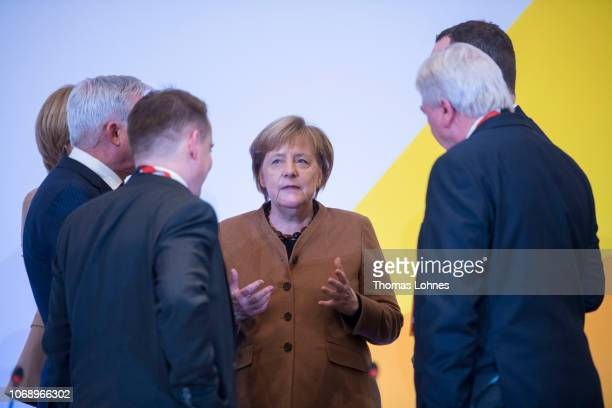 German Chancellor and leader of the German Christian Democrats Angela Merkel speaks to party members during the federal executive board meeting on...
