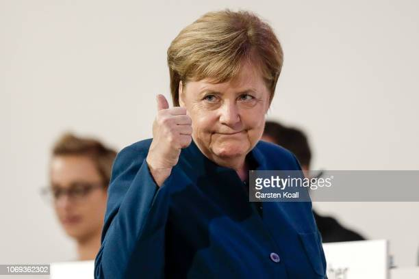 German Chancellor and leader of the German Christian Democrats Angela Merkel waves to the delegates after their speach at the 31 Federal Party...