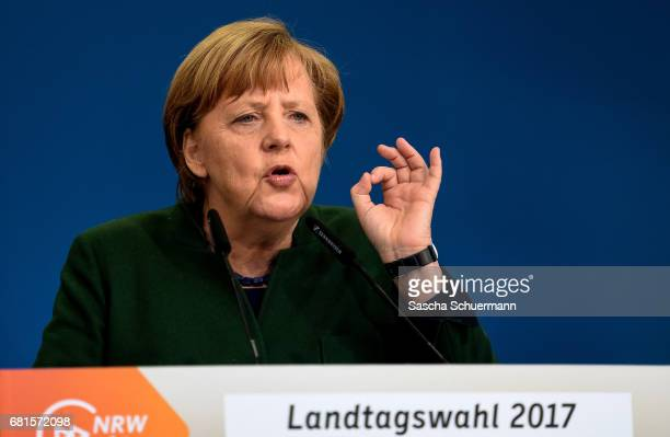 German Chancellor and leader of the German Christian Democrats Angela Merkel speaks to supporters while campaigning for the CDU ahead of state...