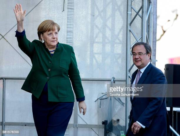 German Chancellor and leader of the German Christian Democrats Angela Merkel and lead CDU candidate Armin Lachet greets supporters while campaigning...