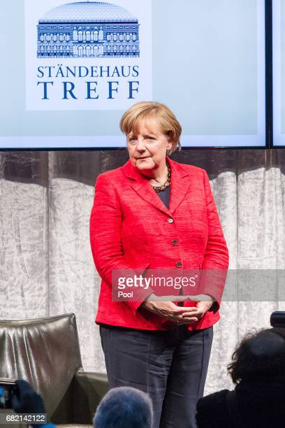 German Chancellor and leader of the German Christian Democrats Angela Merkel attends a reception held by the Rheinischer Post newspaper ahead of...