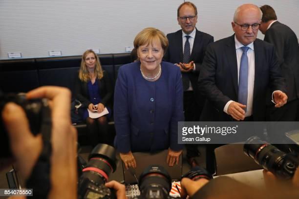 German Chancellor and leader of the German Christian Democrats Angela Merkel and CDU Bundestag faction leader Volker Kauder arrive for a joint...