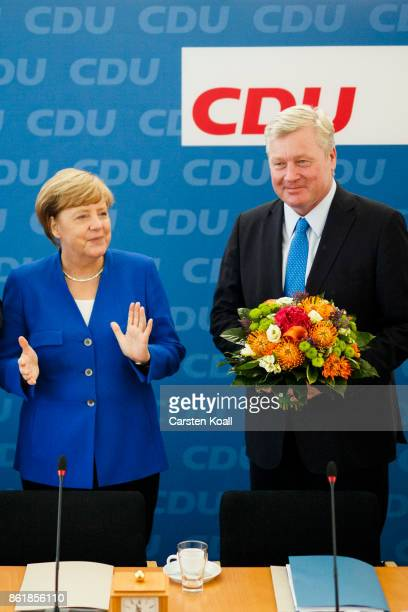 German Chancellor and leader of the German Christian Democrats Angela Merkel applauds CDU lead candidate in yesterday's state elections in Lower...
