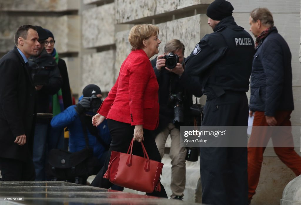 German Chancellor and leader of the German Christian Democrats (CDU) Angela Merkel arrives at the Reichstag for the first session of the Bundestag, the German parliament, since the collapse of government coalition talks on November 21, 2017 in Berlin, Germany. Preliminary coalition talks, after over three weeks of arduous meetings, fell apart Sunday night, leaving Merkel confronted with two uncomfortable possibilities: attempt to run a minority government together with the German Greens Party or submit to new elections. Both would be a first at the federal level in post-World War II German history.