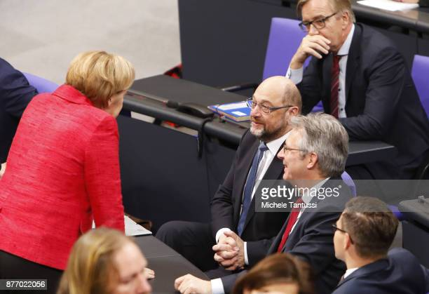 German Chancellor and leader of the German Christian Democrats Angela Merkel speaks with Martin Schulz leader of the Social Democrats Party or during...