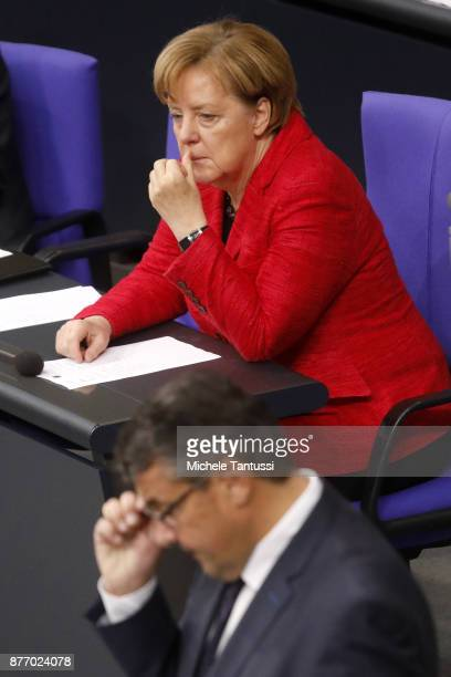 German Chancellor and leader of the German Christian Democrats Angela Merkel listens to Germany's Foreign minister Sigmar Gabriel during the first...