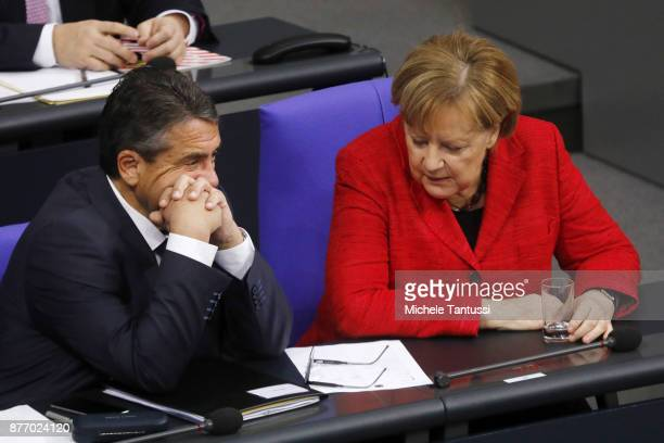 German Chancellor and leader of the German Christian Democrats Angela Merkel speaks with Sigmar Gabriel Foreign minister of the Social Democrats...