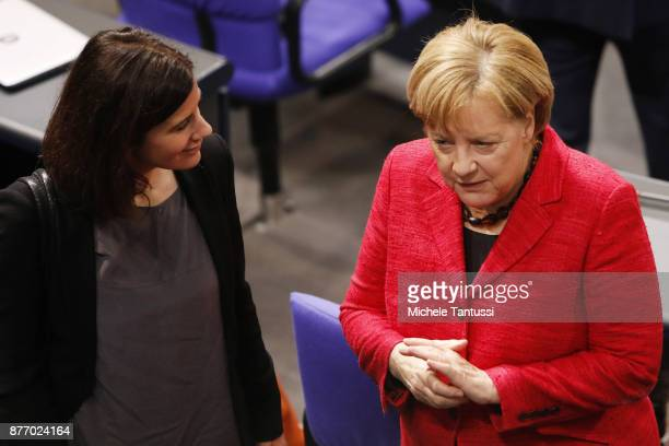 German Chancellor and leader of the German Christian Democrats Angela Merkel speaks with Katja Suding of the FDP party during the first session of...