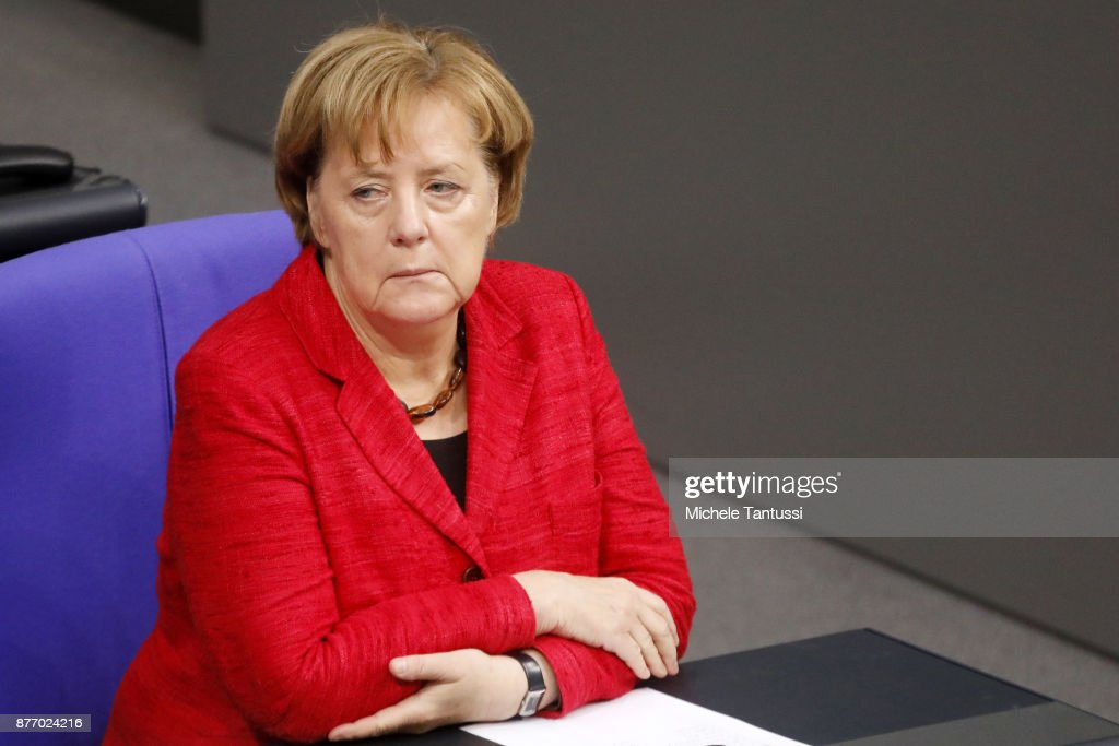 German Chancellor and leader of the German Christian Democrats (CDU) Angela Merkel pauses during the first session of the Bundestag, the German parliament, since the collapse of government coalition talks on November 21, 2017 in Berlin, Germany. Preliminary coalition talks, after over three weeks of arduous meetings, fell apart Sunday night, leaving Merkel confronted with two uncomfortable possibilities: attempt to run a minority government together with the German Greens Party or submit to new elections. Both would be a first at the federal level in post-World War II German history.