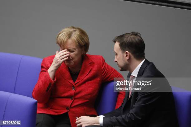 German Chancellor and leader of the German Christian Democrats Angela Merkel speaks with Paul Ziemiak chairman of the young associacion of the CDU...