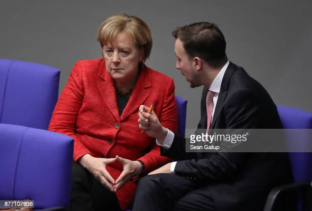 German Chancellor and leader of the German Christian Democrats Angela Merkel speaks with Paul Ziemiak head of the Junge Union the youth party of the...