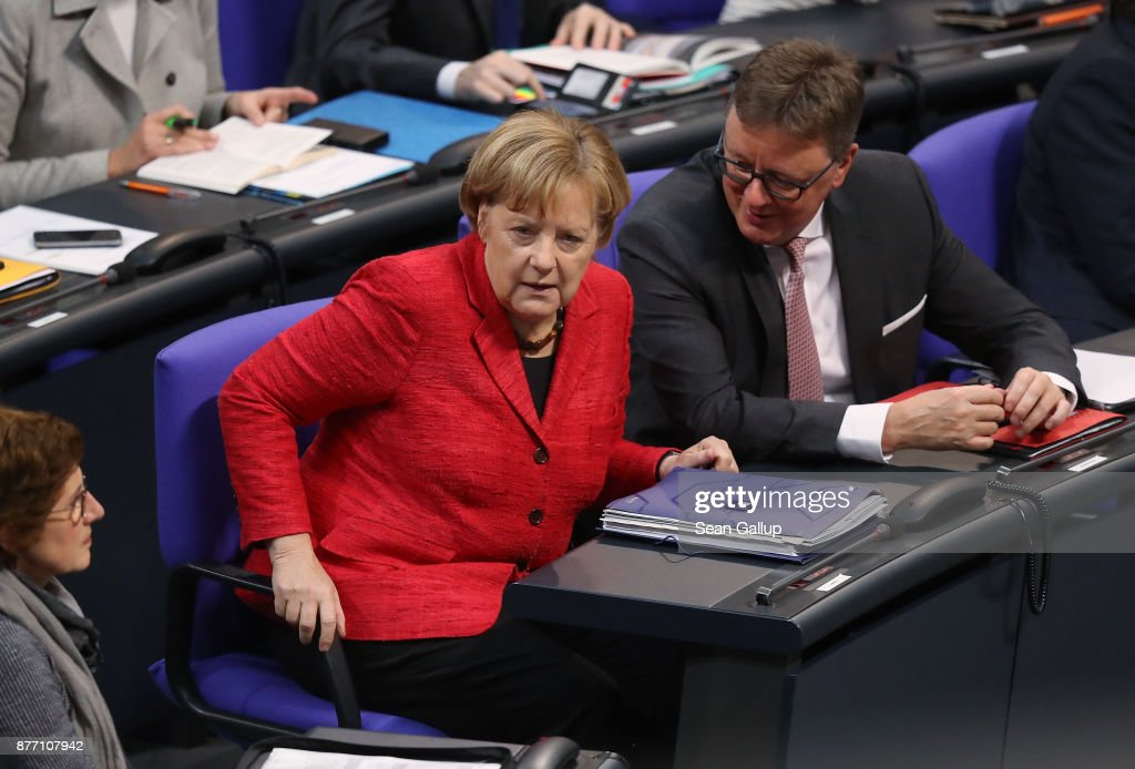 German Chancellor and leader of the German Christian Democrats (CDU) Angela Merkel attends the first Bundestag session since the collapse of government coalition talks on November 21, 2017 in Berlin, Germany. Preliminary coalition talks, after over three weeks of arduous meetings, fell apart Sunday night, leaving Merkel confronted with two uncomfortable possibilities: attempt to run a minority government together with the German Greens Party or submit to new elections. Both would be a first at the federal level in post-World War II German history.