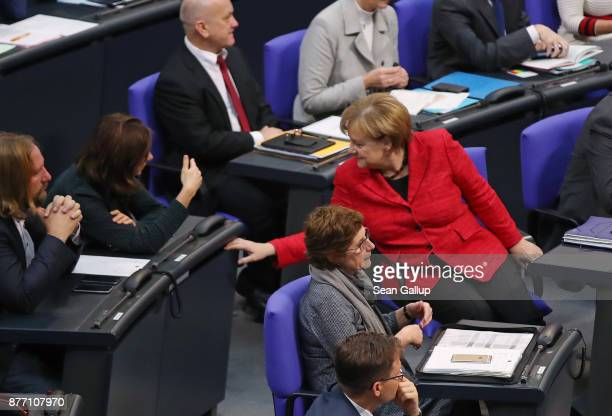 German Chancellor and leader of the German Christian Democrats Angela Merkel speaks with Katrin GoeringEckardt of the German Greens Party at the...