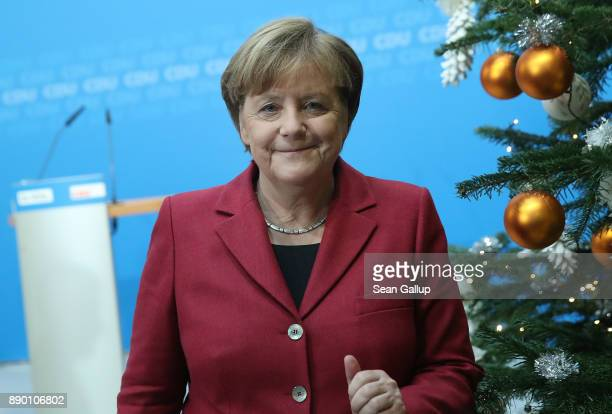 German Chancellor and leader of the German Christian Democrats Angela Merkel walks past a Christmas tree as she departs following a press conference...