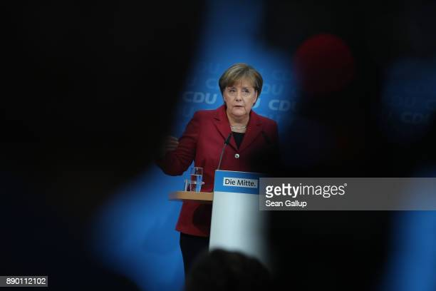 German Chancellor and leader of the German Christian Democrats Angela Merkel speaks to the media at a press conference at CDU headquarters on...