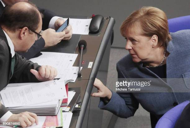 German Chancellor and leader of the German Christian Democrats Angela Merkel speaks with german Federal Minister of Food and Agriculture Christian...