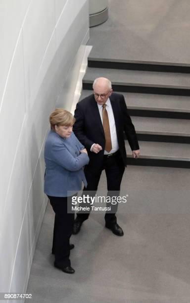 German Chancellor and leader of the German Christian Democrats Angela Merkel speaks with CDU Bundestag fraction head Volker Kauder at the Bundestag...