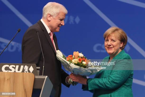 German Chancellor and leader of the German Christian Democrats Angela Merkel receives flowers by Horst Seehofer Governor of Bavaria and leader of the...