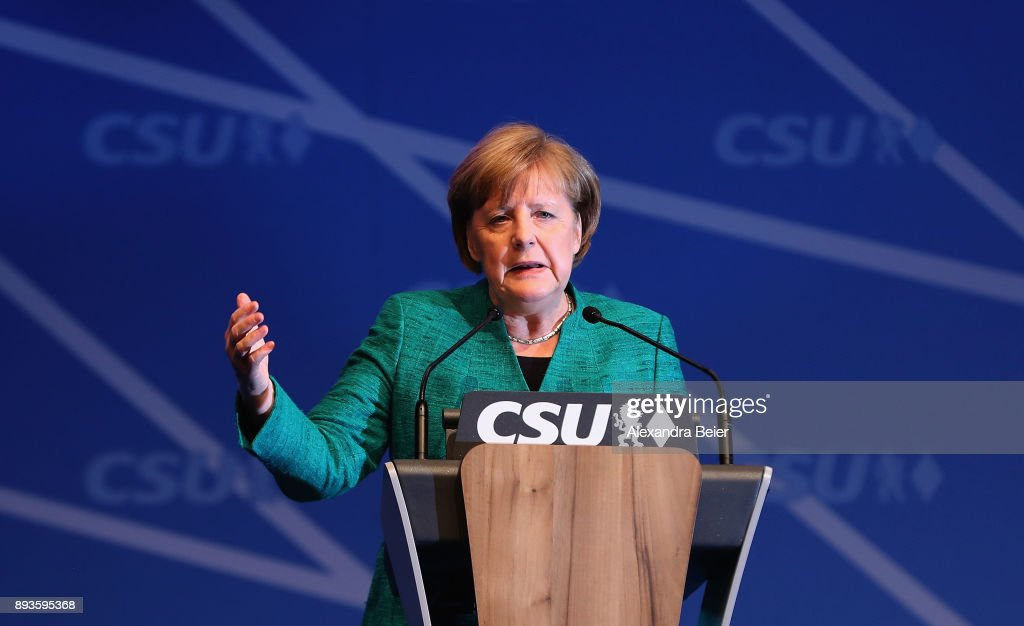 German Chancellor and leader of the German Christian Democrats (CDU) Angela Merkel speaks at the party congress of the CDU sister party, the Bavarian Christian Social Union (CSU), on December 15, 2017 in Nuremberg, Germany. The CDU and CSU have begun initial talks with the German Social Democrats (SPD) in the creation of a coalition government following the collapse of talks with the German Greens Party and the Free Democratic Party (FDP) in November. The CSU has in recent years been led by Horst Seehofer, who has served not only as leader of the party but also as governor of Bavaria, though inner-party power struggles have brought Markus Soeder, a rival to Seehofer, to the fore. While Seehofer will likely be re-elected as leader of the CSU tomorrow, Soeder will run for governor on behalf of the CSU in Bavarian state election to take place in 2018.
