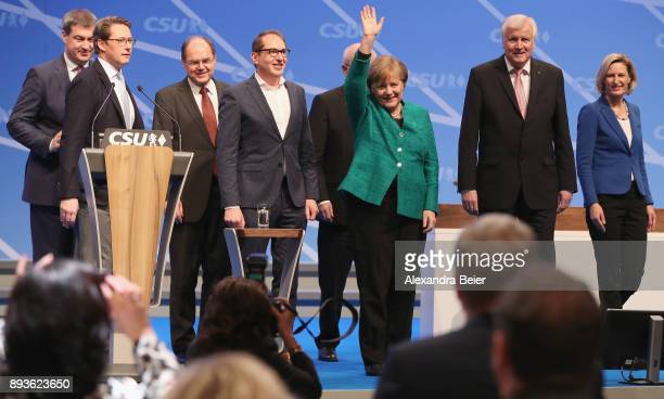 German Chancellor and leader of the German Christian Democrats Angela Merkel waves next to Horst Seehofer Governor of Bavaria and leader of the...