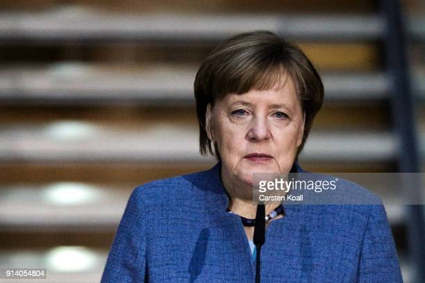 German Chancellor and leader of the German Christian Democrats Angela Merkel speaks to the media at the headquarters of the German Social Democrats...