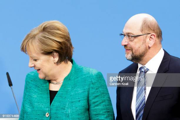 German Chancellor and leader of the German Christian Democrats Angela Merkel and leader of the German Social Democrats Martin Schulz posing for the...
