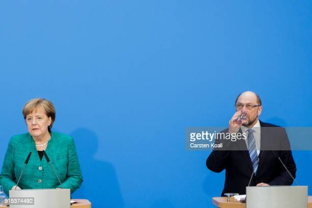 German Chancellor and leader of the German Christian Democrats Angela Merkel and leader of the German Social Democrats Martin Schulz speak to the...