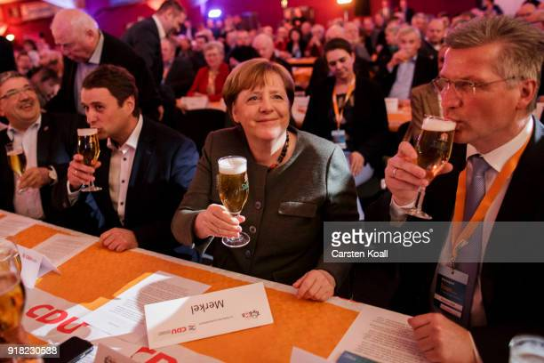 German Chancellor and leader of the German Christian Democrats Angela Merkel cheers to supporters upon her arrival at the CDU political Ash Wednesday...