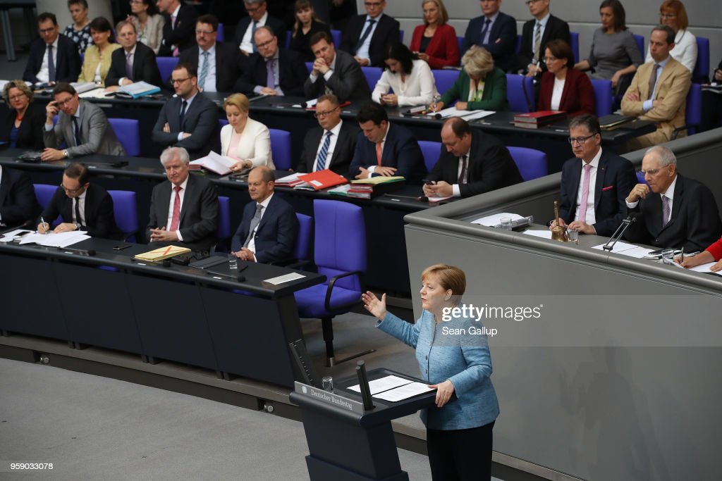 German Chancellor and leader of the German Christian Democrats (CDU) Angela Merkel addresses the Bundestag during debates over the federal budget on May 16, 2018 in Berlin, Germany. Today's debates are likely to be the most intense since the current Bundestag was constituted following last year's federal elections, as the debates will lay bare the central controversies over policy.