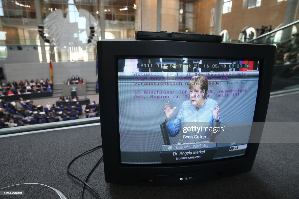German Chancellor and leader of the German Christian Democrats (CDU) Angela Merkel is seen on a monitor as she addresses the Bundestag during debates over the federal budget on May 16, 2018 in Berlin, Germany. Today's debates are likely to be the most intense since the current Bundestag was constituted following last year's federal elections, as the debates will lay bare the central controversies over policy.