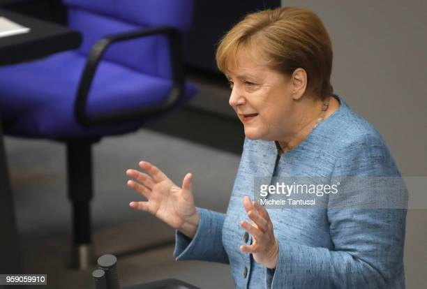 German Chancellor and leader of the German Christian Democrats Angela Merkel addresses the Bundestag during debates over the federal budget on May 16...