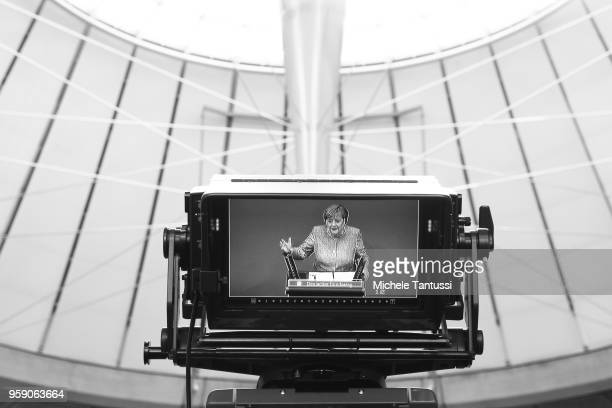 German Chancellor and leader of the German Christian Democrats Angela Merkel is seen on a camera screen as she addresses the Bundestag during debates...