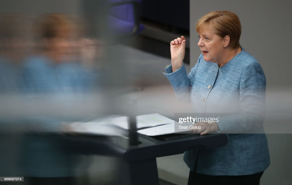 German Chancellor and leader of the German Christian Democrats (CDU) Angela Merkel is reflected in glass as she addresses the Bundestag during debates over the federal budget on May 16, 2018 in Berlin, Germany. Today's debates are likely to be the most intense since the current Bundestag was constituted following last year's federal elections, as the debates will lay bare the central controversies over policy.