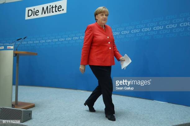 German Chancellor and leader of the German Christian Democrats Angela Merkel departs after speaking to the media following two days of talks amongst...