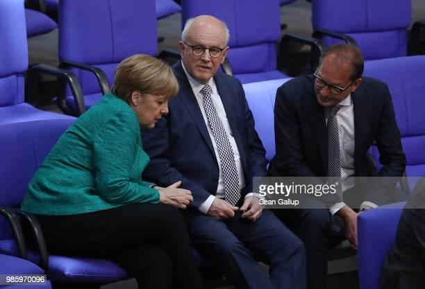 German Chancellor and leader of the German Christian Democrats Angela Merkel speaks with CDU Bundestag faction leader Volker Kauder and Bavarian...
