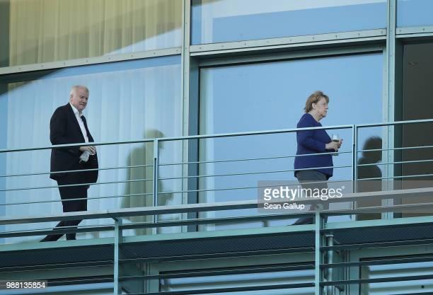 German Chancellor and leader of the German Christian Democrats Angela Merkel and German Interior Minister and leader of the Bavarian Christian...
