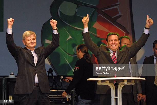 German Chancellor and Social Democrat Gerhard Schroeder and German Foreign Minister and Green Party leader Joschka Fischer gesture at an election...