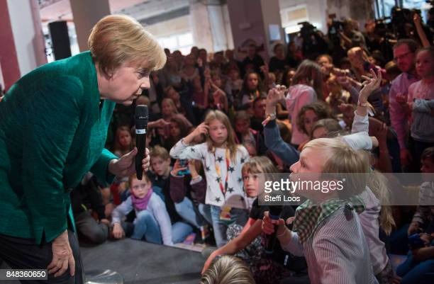 German Chancellor and top candidate of Christian Democrat Union for upcoming federal election Angela Merkel holds a children's press conference at...
