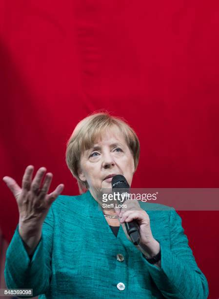 German Chancellor and top candidate of the Christian Democrat Union for the upcoming federal election Angela Merkel holds a children's press...