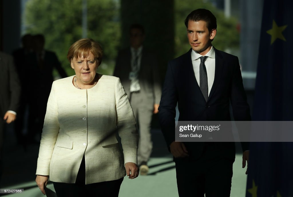 German Chancellor Angeka Merkel and Austrian Chancellor Sebastian Kurz arrive to speak to the media following talks at the Chancellery on June 12, 2018 in Berlin, Germany. High on the two leader's topics of discussion was migration policy.