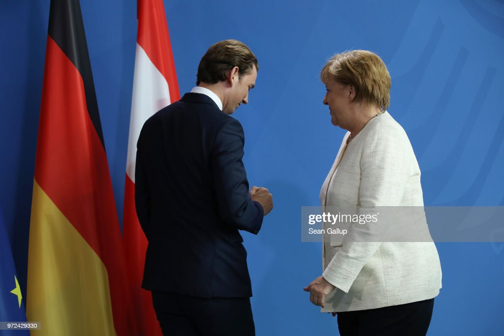 German Chancellor Angeka Merkel and Austrian Chancellor Sebastian Kurz prepare to depart after speaking to the media following talks at the Chancellery on June 12, 2018 in Berlin, Germany. High on the two leader's topics of discussion was migration policy.