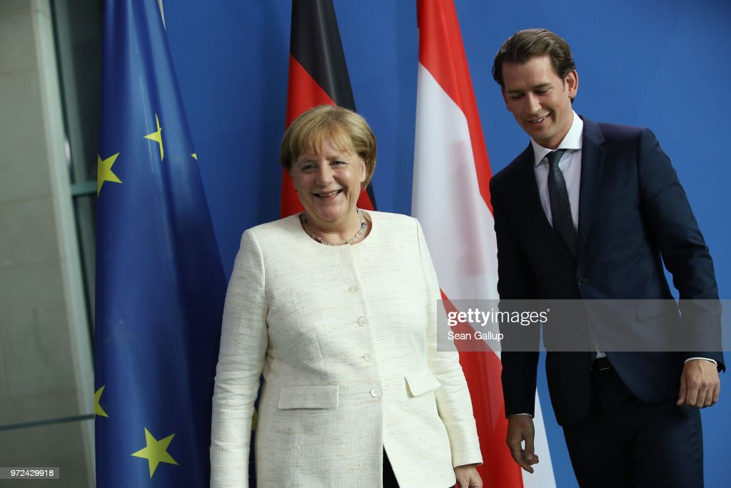 German Chancellor Angeka Merkel and Austrian Chancellor Sebastian Kurz depart after speaking to the media following talks at the Chancellery on June 12, 2018 in Berlin, Germany. High on the two leader's topics of discussion was migration policy.