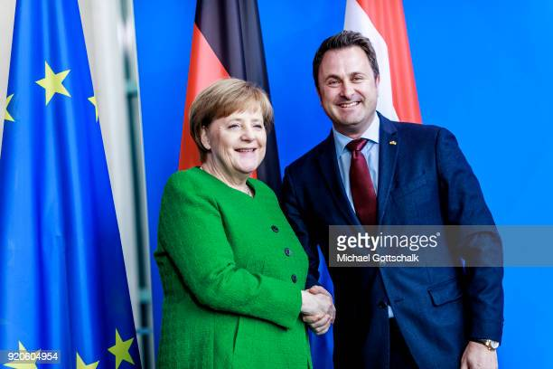 German Chancellor Angeka Merkel and Luxembourg Prime Minister Xavier Bettel attend a meeting with the media following talks at the Chancellery on...