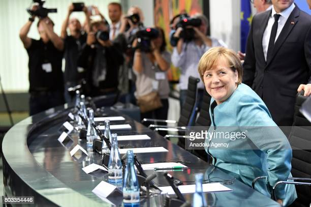 German Chancellor Angela attends a press conference after a gathering of European leaders on the upcoming G20 summit in the Chancellery in Berlin...
